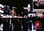 Image of Times Square neon lights New York City USA, 1954, second 42 stock footage video 65675021109