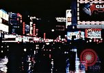 Image of Times Square neon lights New York City USA, 1954, second 43 stock footage video 65675021109