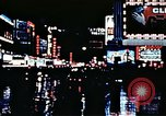 Image of Times Square neon lights New York City USA, 1954, second 44 stock footage video 65675021109