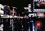 Image of Times Square neon lights New York City USA, 1954, second 52 stock footage video 65675021109