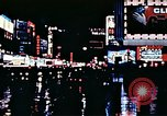 Image of Times Square neon lights New York City USA, 1954, second 56 stock footage video 65675021109