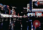 Image of Times Square neon lights New York City USA, 1954, second 57 stock footage video 65675021109