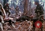 Image of Soldiers carry wounded South Vietnam, 1967, second 30 stock footage video 65675021189