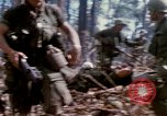 Image of Soldiers carry wounded South Vietnam, 1967, second 31 stock footage video 65675021189
