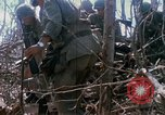 Image of Soldiers carry wounded South Vietnam, 1967, second 55 stock footage video 65675021189