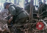 Image of Soldiers carry wounded South Vietnam, 1967, second 56 stock footage video 65675021189