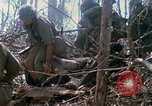 Image of Soldiers carry wounded South Vietnam, 1967, second 58 stock footage video 65675021189