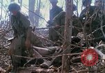 Image of Soldiers carry wounded South Vietnam, 1967, second 59 stock footage video 65675021189
