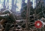 Image of Soldiers carry wounded South Vietnam, 1967, second 60 stock footage video 65675021189