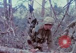 Image of Soldiers help injured South Vietnam, 1967, second 23 stock footage video 65675021190