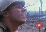 Image of Soldiers help injured South Vietnam, 1967, second 33 stock footage video 65675021190