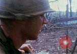 Image of Soldiers help injured South Vietnam, 1967, second 36 stock footage video 65675021190