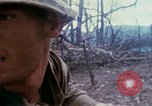 Image of Soldiers help injured South Vietnam, 1967, second 37 stock footage video 65675021190