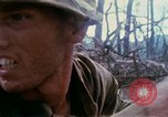 Image of Soldiers help injured South Vietnam, 1967, second 40 stock footage video 65675021190