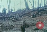 Image of wounded rescued by Huey helicopter South Vietnam, 1967, second 22 stock footage video 65675021192