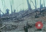 Image of wounded rescued by Huey helicopter South Vietnam, 1967, second 23 stock footage video 65675021192