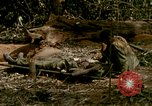 Image of wounded rescued by Huey helicopter South Vietnam, 1967, second 37 stock footage video 65675021192