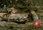 Image of wounded rescued by Huey helicopter South Vietnam, 1967, second 38 stock footage video 65675021192
