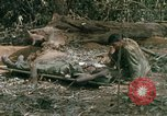 Image of wounded rescued by Huey helicopter South Vietnam, 1967, second 40 stock footage video 65675021192