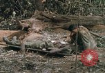 Image of wounded rescued by Huey helicopter South Vietnam, 1967, second 42 stock footage video 65675021192
