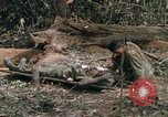 Image of wounded rescued by Huey helicopter South Vietnam, 1967, second 44 stock footage video 65675021192