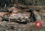 Image of wounded rescued by Huey helicopter South Vietnam, 1967, second 46 stock footage video 65675021192