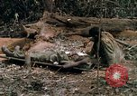Image of wounded rescued by Huey helicopter South Vietnam, 1967, second 47 stock footage video 65675021192