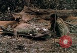 Image of wounded rescued by Huey helicopter South Vietnam, 1967, second 48 stock footage video 65675021192