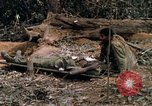 Image of wounded rescued by Huey helicopter South Vietnam, 1967, second 49 stock footage video 65675021192