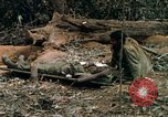 Image of wounded rescued by Huey helicopter South Vietnam, 1967, second 50 stock footage video 65675021192