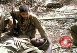 Image of wounded rescued by Huey helicopter South Vietnam, 1967, second 51 stock footage video 65675021192
