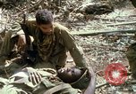 Image of wounded rescued by Huey helicopter South Vietnam, 1967, second 52 stock footage video 65675021192