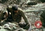 Image of wounded rescued by Huey helicopter South Vietnam, 1967, second 53 stock footage video 65675021192