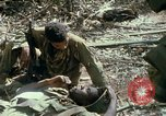 Image of wounded rescued by Huey helicopter South Vietnam, 1967, second 54 stock footage video 65675021192