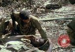 Image of wounded rescued by Huey helicopter South Vietnam, 1967, second 55 stock footage video 65675021192