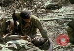 Image of wounded rescued by Huey helicopter South Vietnam, 1967, second 56 stock footage video 65675021192
