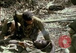Image of wounded rescued by Huey helicopter South Vietnam, 1967, second 57 stock footage video 65675021192
