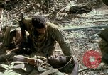 Image of wounded rescued by Huey helicopter South Vietnam, 1967, second 58 stock footage video 65675021192