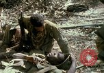 Image of wounded rescued by Huey helicopter South Vietnam, 1967, second 59 stock footage video 65675021192