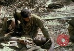 Image of wounded rescued by Huey helicopter South Vietnam, 1967, second 60 stock footage video 65675021192