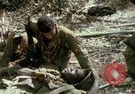 Image of wounded rescued by Huey helicopter South Vietnam, 1967, second 61 stock footage video 65675021192