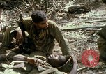 Image of wounded rescued by Huey helicopter South Vietnam, 1967, second 62 stock footage video 65675021192