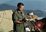 Image of U.S. army chaplain leads service Vietnam, 1968, second 36 stock footage video 65675021201