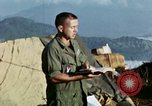 Image of U.S. army chaplain leads service Vietnam, 1968, second 38 stock footage video 65675021201