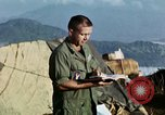 Image of U.S. army chaplain leads service Vietnam, 1968, second 39 stock footage video 65675021201