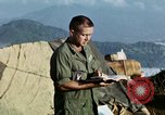 Image of U.S. army chaplain leads service Vietnam, 1968, second 40 stock footage video 65675021201