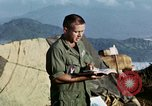 Image of U.S. army chaplain leads service Vietnam, 1968, second 42 stock footage video 65675021201