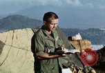Image of U.S. army chaplain leads service Vietnam, 1968, second 43 stock footage video 65675021201