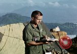 Image of U.S. army chaplain leads service Vietnam, 1968, second 45 stock footage video 65675021201