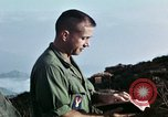 Image of U.S. army chaplain leads service Vietnam, 1968, second 47 stock footage video 65675021201